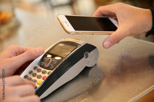 Leinwanddruck Bild Payment transaction with smartphone