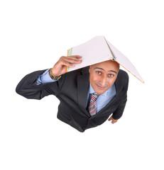 Businessman taking shelter