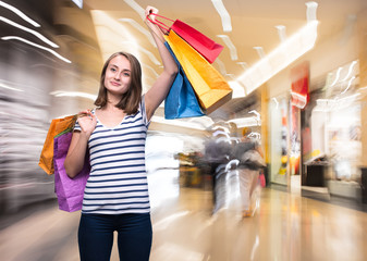 Young teen girl with shopping bags