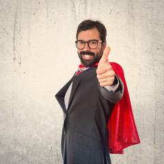 Businessman dressed like superhero with thumb up