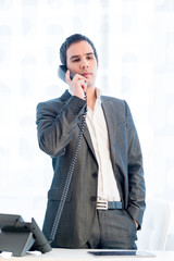 Stylish businessman standing talking on a phone
