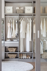 row of black and white dress with shoes in wardrobe