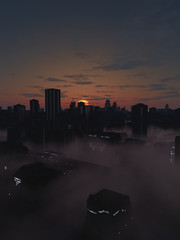 Future City in Dark Misty Sunrise
