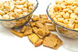 two plates with different nuts and crackers
