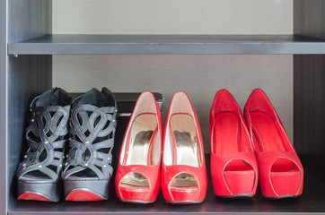 row of red shoes in shelf
