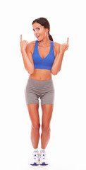 Fit adult female pointing fingers up