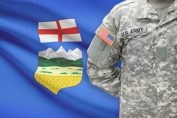 American soldier with Canadian province flag - Alberta