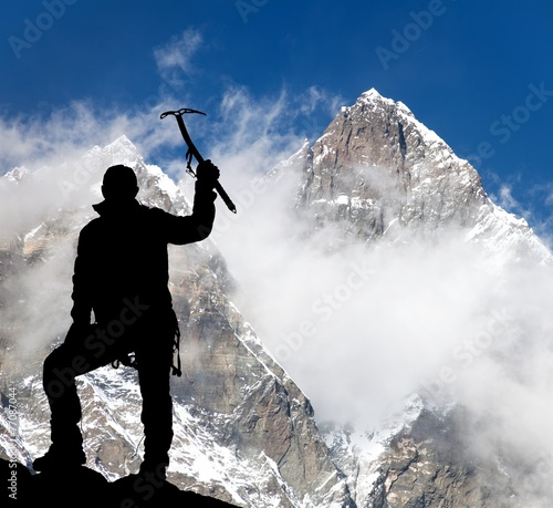 Fotobehang Nepal Mount Lhotse and silhouette of man wirh ice axe