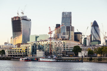 River Thames and Modern Skyscrapers on Background at Sunset
