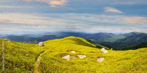 path among stones on mountain top at sunrise © Pellinni