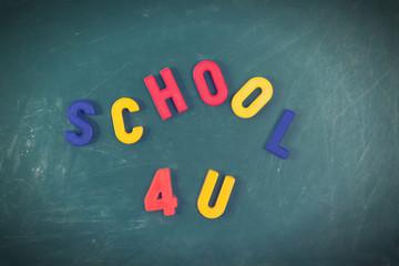School 4 you letters on a blackboard