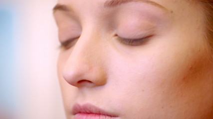 Closeup portrait of beautiful young woman face