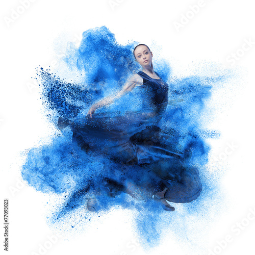 young woman dancing flamenco against explosion