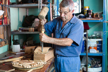 workshop where the cabinetmaker carving wood