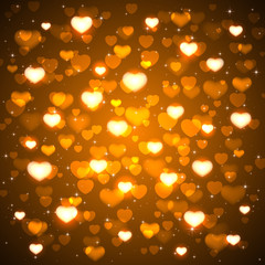 Golden background with blurry hearts