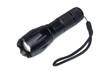 Black metal flashlight. Isolated on white background