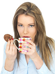 Young Woman Enjoying Tea and Biscuits