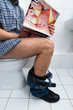 Man In Toilet Holding Sexy Magazine