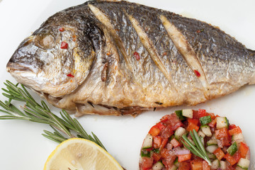 Gourmet Mediterranean seafood dish. Grilled fish gilthead with v
