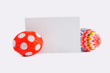 Colorful Easter eggs and blank card