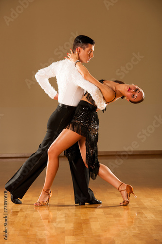 latino dance couple in action - dancing wild samba - 77097678
