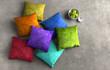 Farbige Kissen auf Steinboden - 77098060