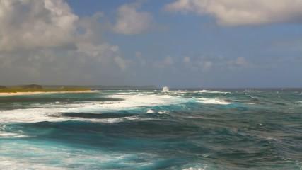 Sea waves on shoal. Anse de Shatto, Guadeloupe