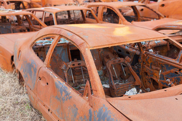 Cemetery of burnt rusty cars