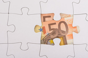 Euro Banknote Hidden Under Jigsaw