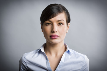 Portrait of candid pretty businesswoman with authentic look.