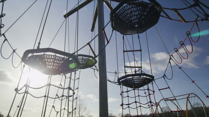 Camera movement over an empty climbing frame in a playground