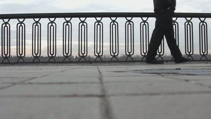 A person walking along the promenade