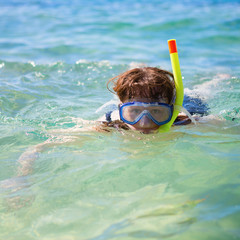 Woman snorkeling in turquoise tropical waters