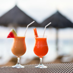 Two fresh juices on a tropical beach