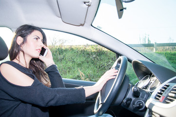 female driver with his smart phone