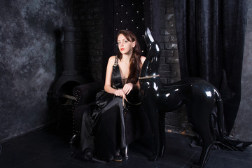 Woman Sitting in Throne with Dog Statue on Leash
