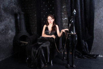 Woman in Black Dress on Throne by Dog Statue