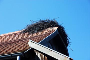 Stork nest on the roof of wooden house in Lonjsko polje