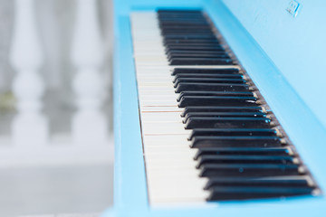 View along a blue piano keyboard