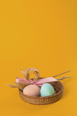 Easter composition of painted eggs and sheaf of wheat card