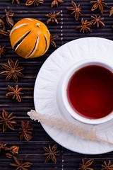 Cosy cup with rooibos tea and sugar stick