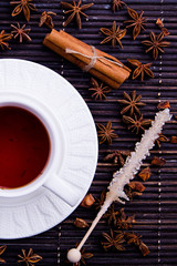Winter cosy cup with rooibos tea, cinamom, anise and sugar stick