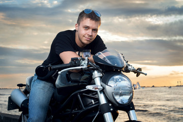 Friendly guy on a motorcycle smiling at the camera