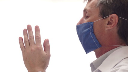 Doctor With Mask Praying Side View