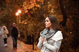 Young woman portrait autumn evening.