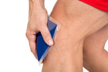 Hand Holding Ice Gel Pack On Knee