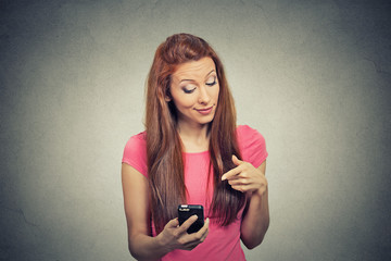 angry woman unhappy annoyed by something on cell phone