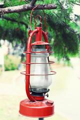 Kerosene lamp hanging on fir tree, outdoors