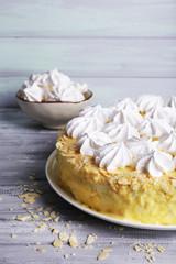 Tasty homemade meringue cake on wooden table