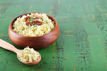Rice with walnuts and rosemary in plate